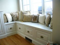This might be exactly what I do in the play room... I heart the corner window seat with the big drawers underneath.