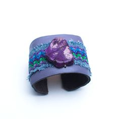Lilac Lady cuff by Monique Sparks Designs. American Made. See the designer's work at the 2015 American Made Show, Washington DC. January 16-19, 2015. americanmadeshow.com #cuff, #bracelet, #jewelry, #leather, #purple, #americanmade