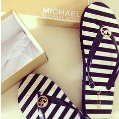 MK stripped slippers