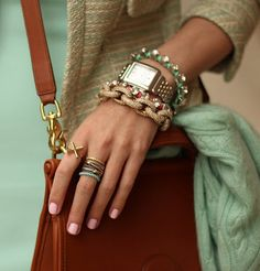 "The grown-up ""arm party"": Who knew your pricey heirloom watch paired so well with fun costume jewelry?"