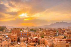 sunrise over golden city lighted