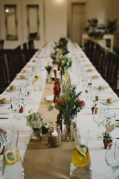 Reception venue, long tables, hessian runners, Australian native, eucalyptus, malt, jars, candles, rustic, earthy, neutral, succulent, place names, bonbonniere
