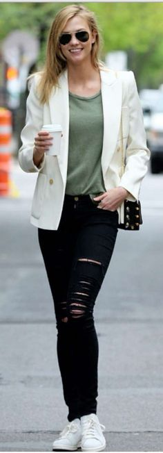 Karlie Kloss: Sunglasses – Ray Ban  Shoes – Adidas  Jeans – Frame  Jacket – Isabel Marant  Purse – Jimmy Choo