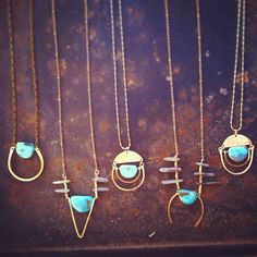 /O\  Inspired by Incan mythology of the sun god, Inti. Brass hammered half moon shape, hangs hand forged arches with a natural turquoise