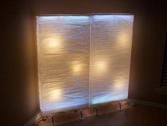Create lit panels using IKEA's Orgel paper lamp.