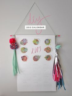 DIY: Printable calendar with pom pom and tissue paper tassel decorations.