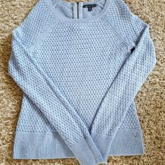 Light blue American Eagle sweater Perfect condition. Wore one time. Cute zipper accent in the back. Make me an offee!!! American Eagle Outfitters Sweaters Crew & Scoop Necks