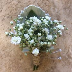 simple baby's breath and twin boutonniere with dusty miller foliage