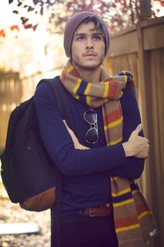 Men's fall look. #Navysweater, #multi-coloredwinterscarf, #men'sbeanie, #blackjeans, #brownleatherbelt, accessorized with a #navyandleatherbackpack and #classicaviators. #mens #fashion #style #winter #hipster #fall