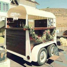 Horse trailer turned into a bar. Would be cool at a barn wedding location.