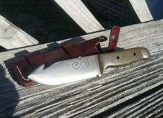 """Lucy Custom Knives - Just finished. Bushcraft/Hunting blade with guthook. Olive micarta scales with red spacer and tubular stainless pins. Full convex grind, 1095 steel 3/16 thick. 8.5"""" overall with a multi-carry bushcraft style sheath. Acid etched and treated blade..."""