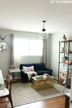 We are loving this cozy space with glam and gold accents! White, navy, gray, and gold work so well together in this functional room. ideas with couch Mix & Match Metallic Office Reveal - DIY Playbook Cozy Home Office, Home Office Space, Home Office Design, Home Office Furniture, Home Office Decor, Small Office, Home Decor, Office With Couch, Office Ideas