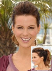 Kate Beckinsale.  Hair teased on top for volume, then controlled back in a ponytail.