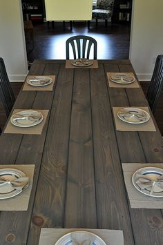 ok, this is my dining table. Now i have to figure out how to get the carpenter to make something like this, with mismatched chairs and a bench