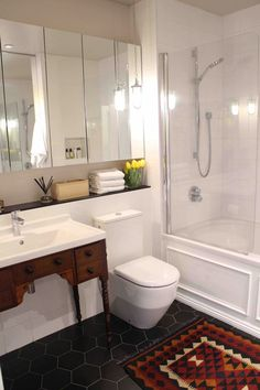 Traditional Meets Modern, Antique vanity, hexagon black tiles, white square wall tiles, mirror cabinets, white and black, kilim rug