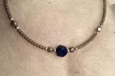 lapis lazuli bead at center of simple wearable stackable bangle bracelet by Urockitjewels on Etsy