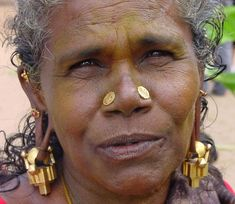 South India | A woman from Tamil Nadu wearing traditional earrings | ©François Villaret