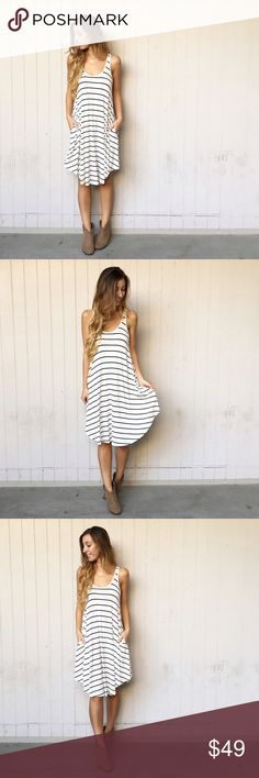 FLASH SALE • LAST ITEM | new | striped midi dress offers welcome new with tag ivory tank midi dress with black stripes and side pockets. modeling size small. •971067•  instagram: @xomandysue Dresses Midi
