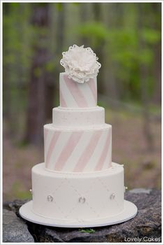 by Lovely Cakes  | TheCakeBlog.com (Minus the horse shoes, this cake is darling!)