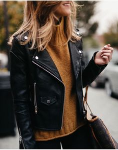 Rust colored turtleneck sweater with an all black outfit 8536367d2d101