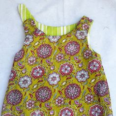 reversable a-line baby/toddler dress tutorial. Looks very easy! http://bloomsnbugs.blogspot.com/2011/08/sew-easy-part-6-reversible-zen-dress.html
