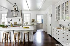 """Kitchen walls are sheathed in subway tiles """"like the French bakeries I love,"""" designer and owner Jeannette Whitson says of her Nashville house. """"And I designed long, shallow drawers like those in old English servants' quarters."""" The nine-and-a-half-foot island is topped with Calacatta marble and has a sink fitted with a Waterstone Gantry faucet. A custom steel hood is paired with a Lacanche range."""