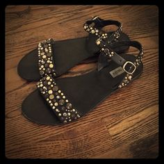 Black studded embellished sandals Black with silver, gold, and charcoal studs with gold buckle. Barely worn all but a couple times. Steve Madden Shoes Sandals