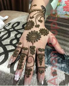 Discover delightful and simple henna designs for girls to adorn their hands and feet for any event. Additionally, henna plays an important role in our weddings and functions. Floral Henna Designs, Mehndi Designs Book, Mehndi Design Pictures, Modern Mehndi Designs, Mehndi Designs For Girls, Beautiful Henna Designs, Arabic Mehndi Designs, Latest Mehndi Designs, Henna Tattoo Designs