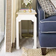 trim on the edge of solid, neutral curtains. Also like the contrast piping on the sofa, details baby, details!