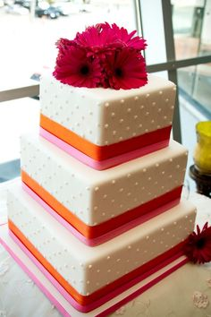 wedding cake with bright orange and pink and simple dots by Gimme Some Sugar Las Vegas