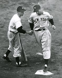 Congratulations, Joltin' Joe - 1949..........A batboy shakes the hand of Joe DiMaggio as he crossed home plate after hitting a home run during the 1949 World Series against the Brooklyn Dodgers at Ebbets Field. October 9, 1949. Photo by The New York Times, courtesy of the U.S. National Archives.