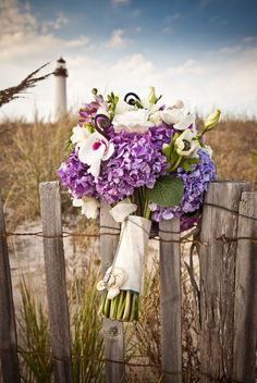 @Allison j.d.m Brazell  I just love the concept of this photo.  The bouquet in the foreground and the sea oats and lighthouse in the background.  Maybe something like this could be done.