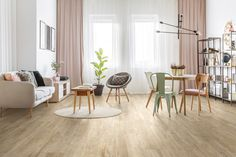 Picture of Heathers on round table and mint and wooden chair in bright living room interior with grey chair, plant and pink drapes stock photo, images and stock photography. Rugs In Living Room, Living Room Interior, Chairs For Kitchen Island, Circular Rugs, Natural Wood Table, Circular Dining Table, Dining Room Inspiration, Table And Chair Sets, Cool Rugs