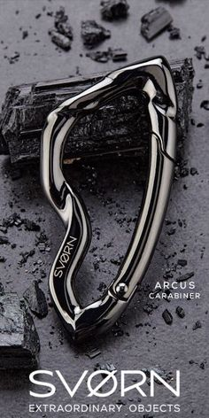 """""""An extraordinary take on an ordinary object."""" A defining piece of art and function, the Arcus carabiner blends the ferocity of sharp edges with smooth body lines. Crafted from Zinc alloy, the carabin"""