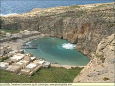 Calypso´s cave - Gozo - Inland Sea at Dwejra, Malta. The Inland Sea is connected to the Mediterranian Sea by a narrow tunnel. On calm days fisher boats can pass the tunnel. This photo has been taken on a rather windy day giving rise to high waves which propagate through the tunnel right into the Inland Sea.
