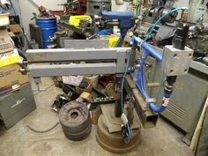 Bead Roller by ROADSTER1927 -- Homemade bead roller constructed from square tubing, roller dies, pipe, and a truck wheel. http://www.homemadetools.net/homemade-bead-roller-17