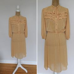 Semi-sheer dark yellow polyester shirtwaist dress with brown pinstripes. Has button front with gold-rimmed opalescent shank buttons. Other details include pussybow tie collar, three accent ruffles along bustline, 3/4 length sleeves with buttoned cuffs, and elastic waist. In excellent vintage Shirtwaist Dress, Shank Button, Mocha Brown, Stunning Dresses, Dusty Rose, Vintage Dresses, 1970s, Elastic Waist, Ruffles