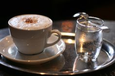 Austrian coffee - a mélange  ~ coffee is always served with a small glass of water
