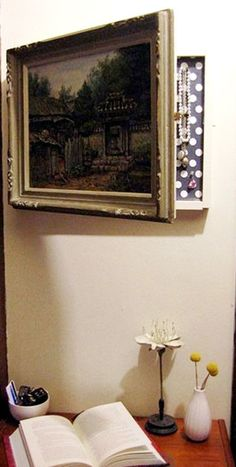 Keep your valuables safe while concealing them behind a beautiful piece of art. Details at Design Sponge