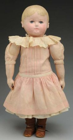 Sweet Chase Child Doll.  Made by Martha Chase, Pawtucket, RI. All cloth with oil-painted head and limbs, large painted blue eyes with thick upper eyelashes, rosy cheeks, closed mouth, rough-textured blonde hair, original paint; clothing appears all original: pink cotton dress, petticoat, half slip and pantaloons, shoes and stockings.
