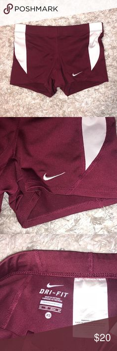 Nike Dri-Fit Shorts Burgundy XS Bought these in every color because I loved the fit and then ended up never wearing half the colors. They are in like new condition with no flaws. Stretchy dri-fit material. Can be tightened with string on inside of shorts. Please ask any questions prior to buying. ***Check our my other listings for other colors. Nike Shorts