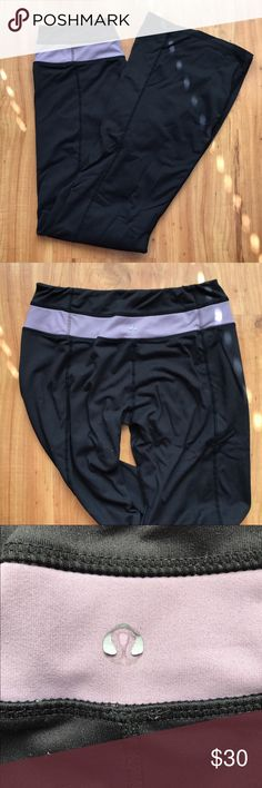 lululemon athletica Black and Purple Groove Pant! Original lululemon athletica Groove Pants! Hard to find!! Fitted to the knee and has the classic flare bell bottom. Has full back stitch all the way down the back. In great condition other than the back sticker which is peeling off but no pilling! Fabric is so soft and these are super comfortable! Make me an offer! lululemon athletica Pants Boot Cut & Flare