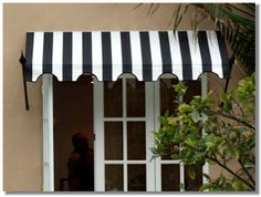 Spear Awnings.  I have considered doing some of these around the house