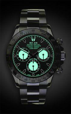 TITAN BLACK Rolex Daytona: Martini Now this one knows how to glow in the dark! Hublot Watches, Men's Watches, Cool Watches, Mens Wrist Watches, Ladies Watches, Casual Watches, Rolex Daytona Black, Black Rolex, Rolex Noir