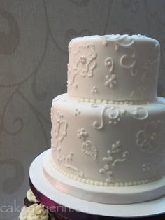 White Embroidered Flowers and Vines Wedding Cake