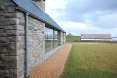 Image 9 of 24 from gallery of House in Blacksod Bay / Tierney Haines Architects. Photograph by Stephen Tierney House Designs Ireland, Houses In Ireland, Ireland Homes, Cottage Exterior, Modern Farmhouse Exterior, Stone Cottages, Stone Houses, Design Exterior, Interior Exterior