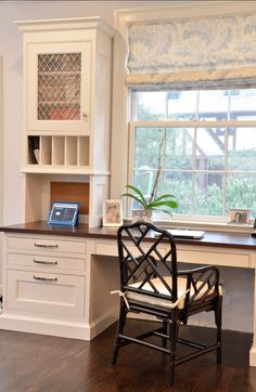 Kitchen Desk. The homeowner has views of the yard from her desk, adjacent to the kitchen. Special vertical slots were designed for paperwork, and the nickel grilles are from Just Grilles in the UK. Roman Shade Fabric is Melbury by Colefax and Fowler. #KitchenDesk