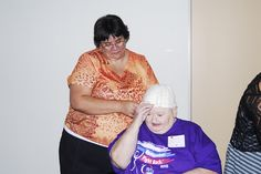 "Cancer patient Charlotte Watchorn tries on a cap during ""Look Good, Feel Better"" recently as volunteer Adrienne Mayo helps her.    ""Look Good, Feel Better"" is an opportunity for cancer patients to receive tips on how to improve their physical appearanc Tips on how to loose Weight Look better  Feel Better change habits more at HFDW"