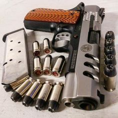 Hmmm A Smith an Wesson 1911 from their custom shop. I bet she is one serious lady! For around $1600-$1800 she better be!