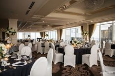 Simply elegant wedding with modern inspiration showcases white spandex chair covers and beautiful linens